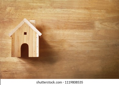 Toy house, on wooden floor