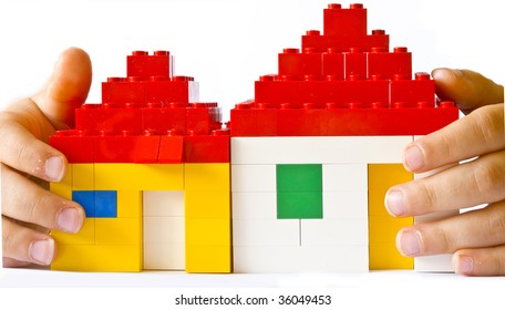 toy houses in child's hands