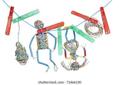 Toy little men and girl were tangled in a network. Toys are made from the internet computer cable