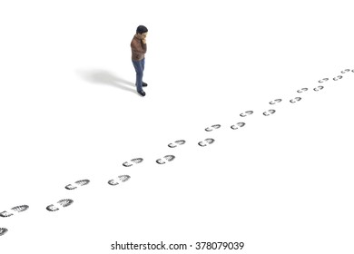 Toy Man Looking at Footprints From a Person on a White Background
