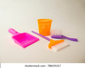Toy MOP, bucket, garbage, brush and scoop for cleaning on white background