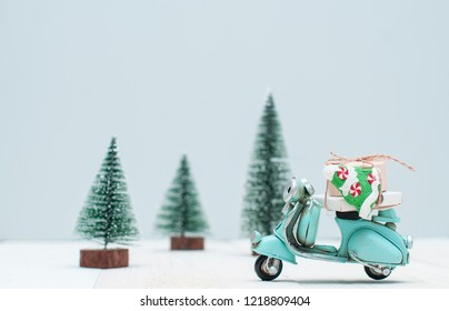 Toy  motorbike with gifts  in christmas trees town