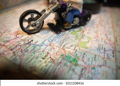 A toy motorcycle pictured with a map of Sturgis, South Dakota.