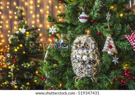 toy owl on a green christmas tree christmas tree decorated with toys balls - Christmas Tree Decorated With Owls