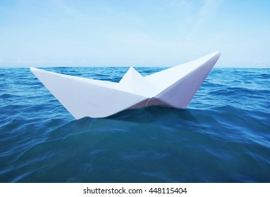 Toy paper ship sails on the sea