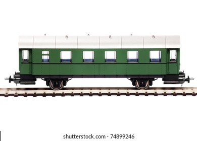 Toy passenger car isolated over white background