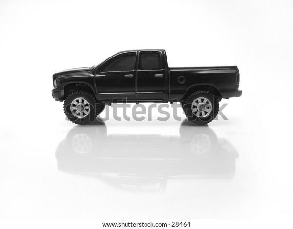 Toy pickup against reflective background.