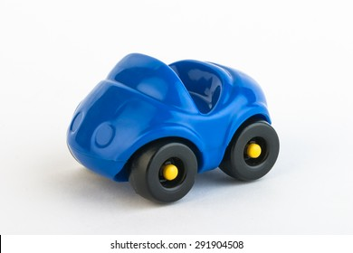 Toy plastic blue car on white background