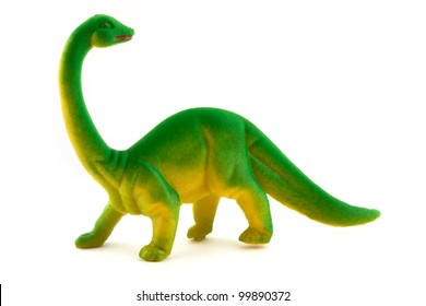 Toy plastic dinosaur over white