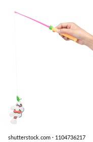 Toy plastic fishing rod with fish isolated on white background