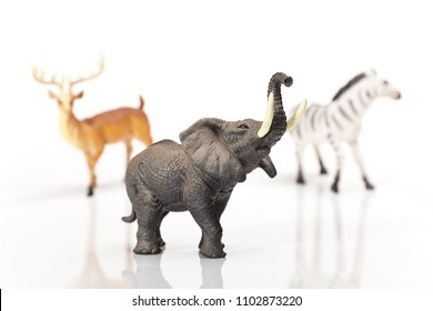 Toy plastic game Elephant on a white background