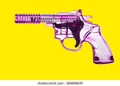 Toy plastic gun isolated