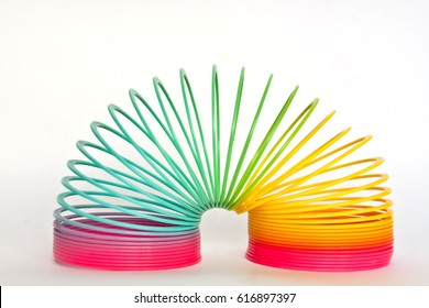 Toy plastic rainbow on a white background, color spiral for play