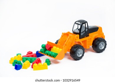 Toy plastic tractor and constructor on a white background