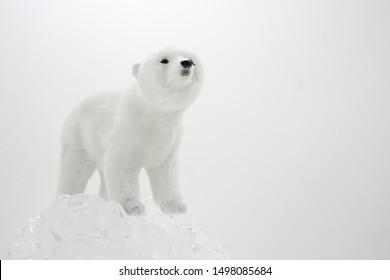A toy polar bear and ice