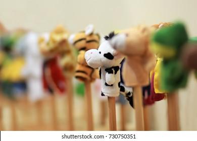 Toy puppets on wooden sticks for preschool nursery theatre. Puppet theater art.