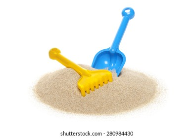 Toy rake and spade isolated on white background