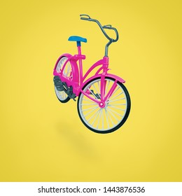 Toy red bike with a blue saddle on a yellow background. Eco-friendly mode of transport.