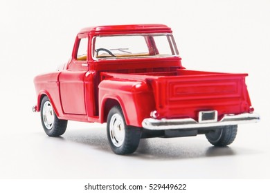 toy red vintage car truck rear view isolated.