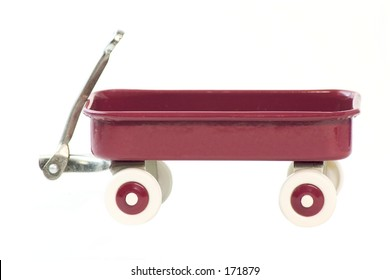 A toy red wagon isolated on a white background.