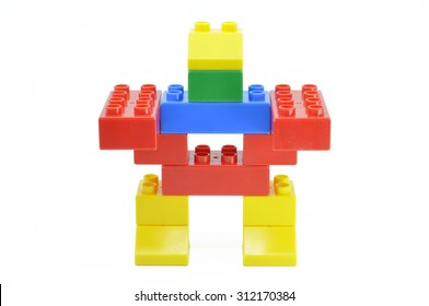 Toy robot made from toy plastic colorful building blocks.