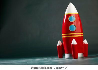 toy rocket on the blackboard