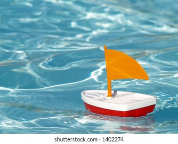 toy sailboat in a swimming pool