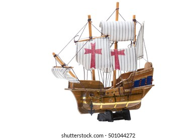 Toy sailing ship on a stand, Columbus Day, isolated on a white background