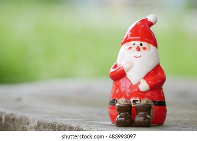 Toy santa claus on blurred background