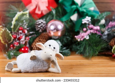 Toy sheep lies at new year background