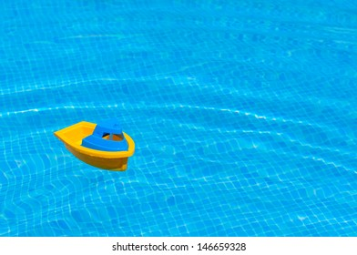Toy ship floating in the water of a swimmingpool