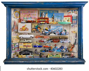 Toy shop window full of tin plate and other retro toys and games.