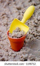 Toy Shovel and Bucket with Sand