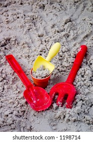 Toy Shovels, Bucket, and Rake with Sand