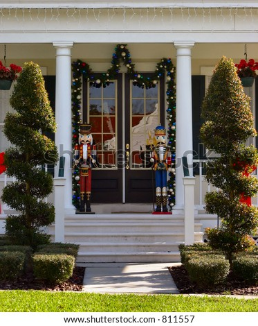 toy soldier christmas decoration on front porch with topiearies - Toy Soldier Christmas Decoration