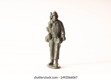 toy soldier, green, alone, on white background