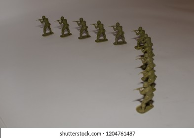 Toy soldiers aiming on a white background