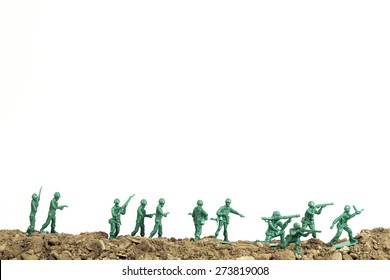 Toy soldiers march along the horizon in war image