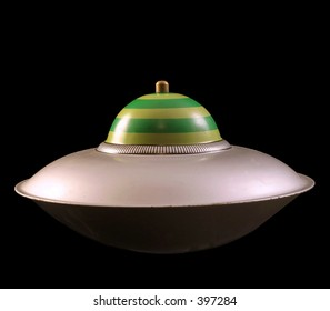 A toy spaceship isolated on a black background.