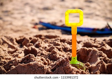 Toy spade on a sandy beach