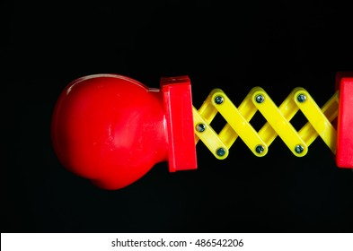 Toy Spring Boxing Glove on Black Background