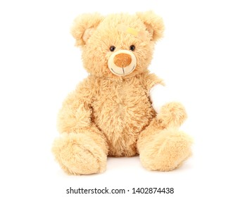 toy teddy bear with bandage isolated on white background