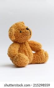 Toy teddy bear on white background