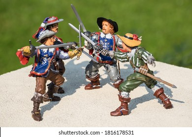 Toy three Musketeers and D'artagnan