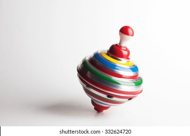 A Toy Top Spinning In Motion Isolated On White Background