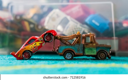 Toy Tow Mater pulling Lightning McQueen after an accident on September 2017 in Poznan, Poland. Toy vehicles a part of the Mattel Disney Cars collection.
