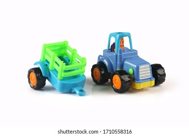 Toy Tractor model with the trailer on a white background