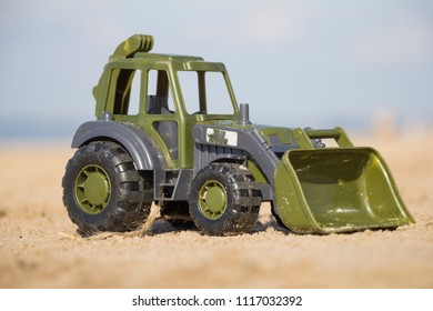 Toy tractor on the sand