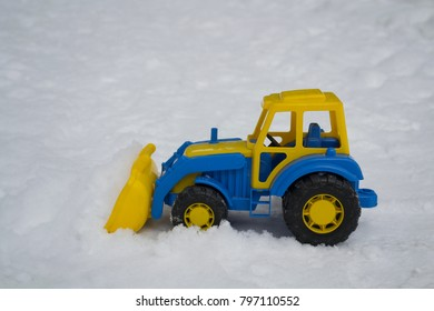 A toy tractor in the snow