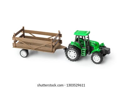 Toy tractor with trailer isolated on white background